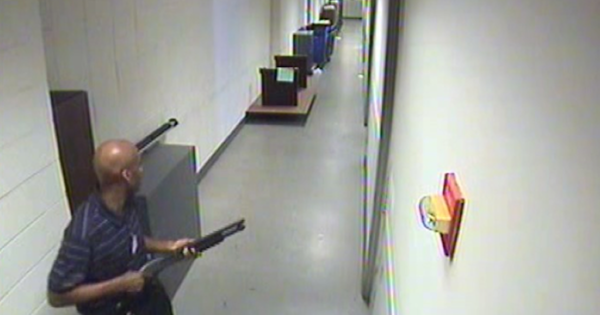 This image taken from an edited video released by the FBI shows Aaron Alexis prowling the halls of the Washington Navy Yard facility.</p>