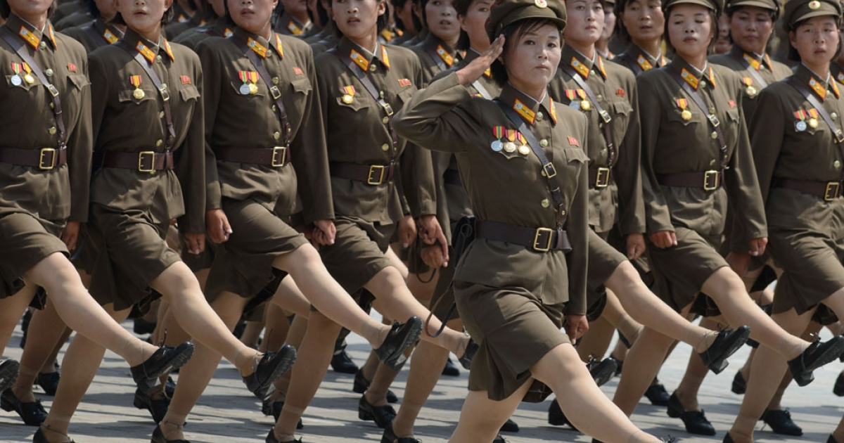 North Korean soldiers march through Kim Il-Sung square in Pyongyang on July 27, 2013, to mark the 60th anniversary of the Korean armistice.</p>