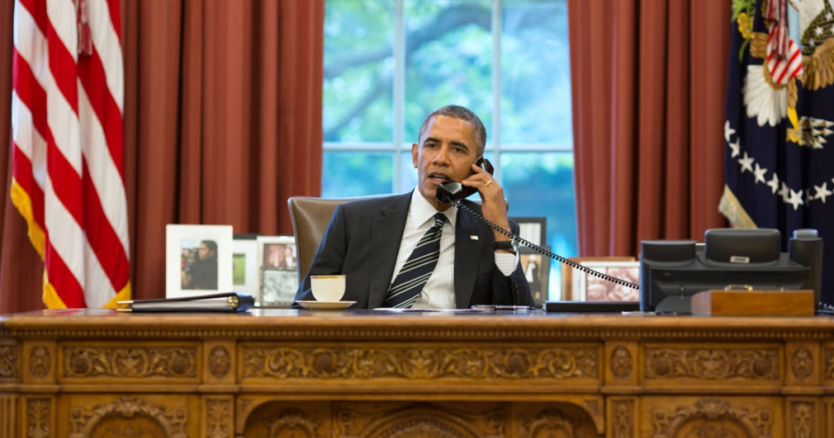 President Barack Obama speaks with President Hassan Rouhani of Iran on the phone in the Oval Office, Sept. 27, 2013.</p>