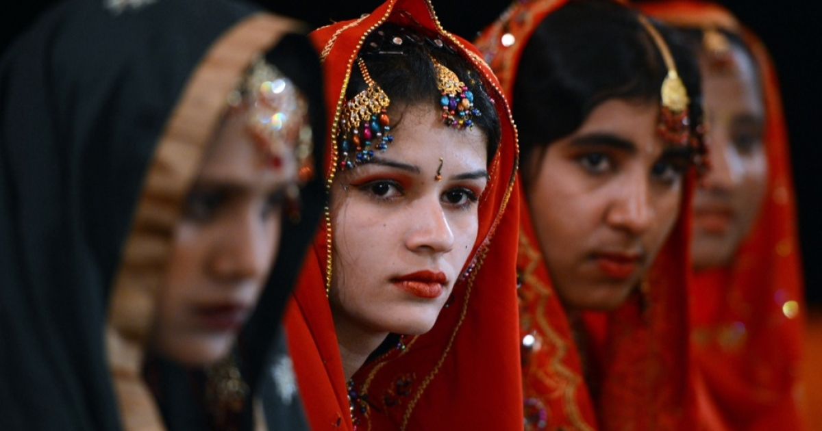 Pakistani brides attend a mass marriage ceremony in Karachi on March 26, 2013.</p>