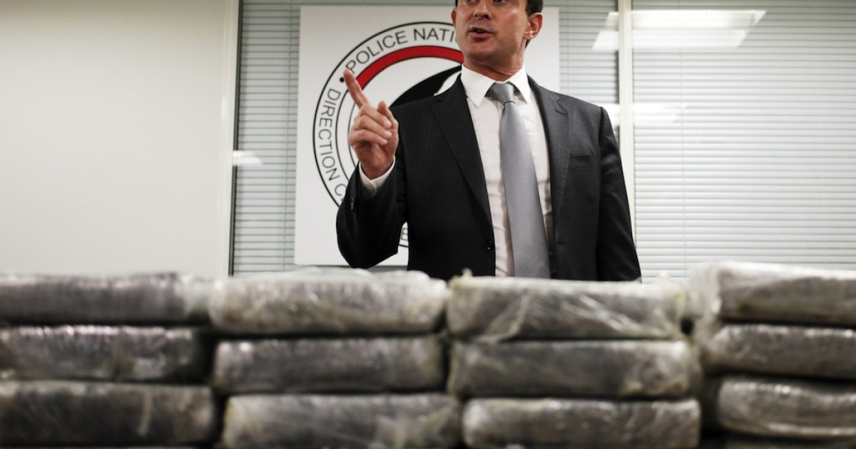 French Interior minister Manuel Valls talks to journalists in front of cocaine seized by French police, on September 21, 2013 in Nanterre, France. Valls announced 1.3 tonnes of pure cocaine was found on board an Air France cargo plane. A source close to the investigation said the flight had originated in the Venezuelan capital Caracas, adding that the haul had a street value of some 200 million euros ($270 million).</p>