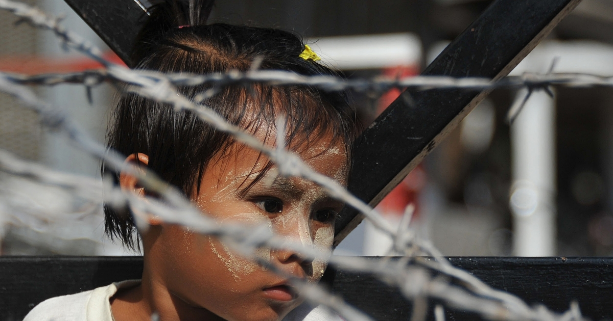 A young girl awaits the release of a relative from Yangon's Insein prison in Yangon in January, 2011. Myanmar has freed hundreds of political prisoners. After successfully liberalizing their government, many of these democracy advocates have returned home to shattered lives and broken families.</p>