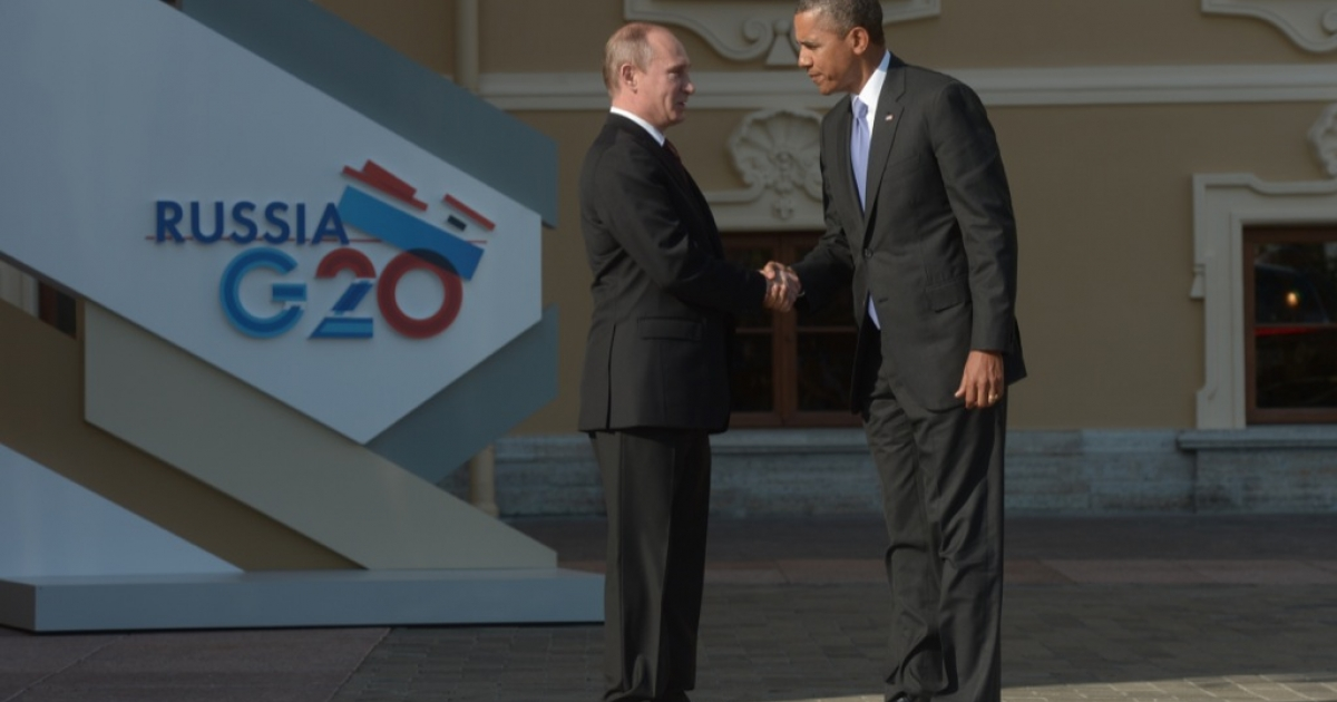 In this handout image provided by Host Photo Agency, Russian President Vladimir Putin greets US President Barack Obama at the G20 summit on Sept. 5, 2013.</p>