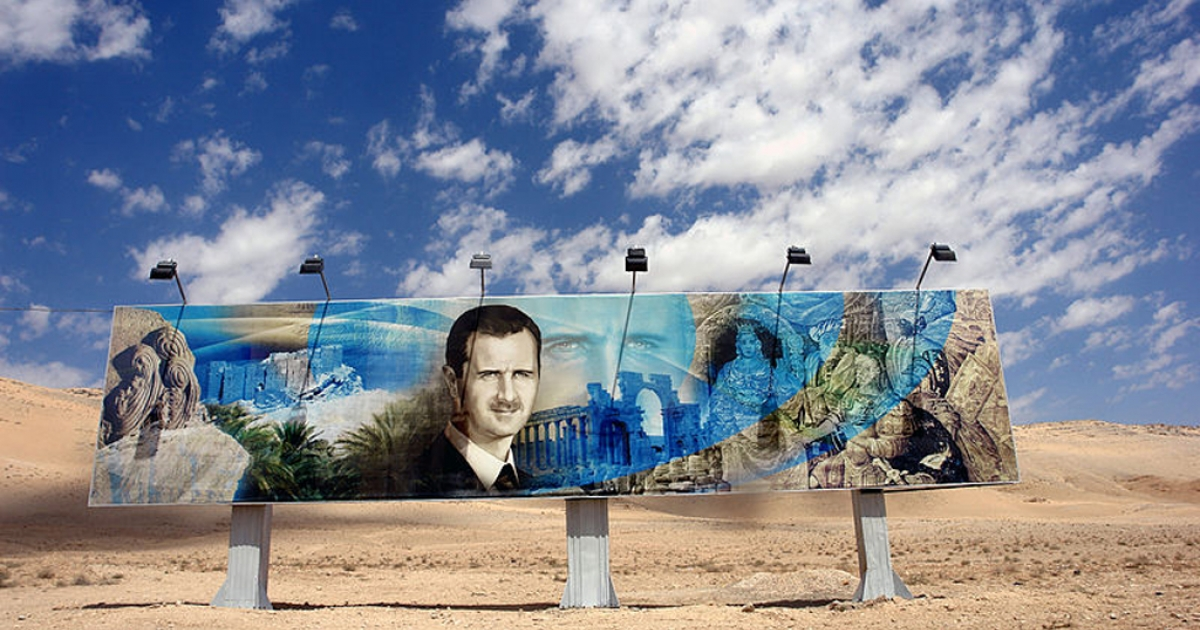 Roadside mural of Bashar al-Assad along the highway in Aleppo, Syria.</p>