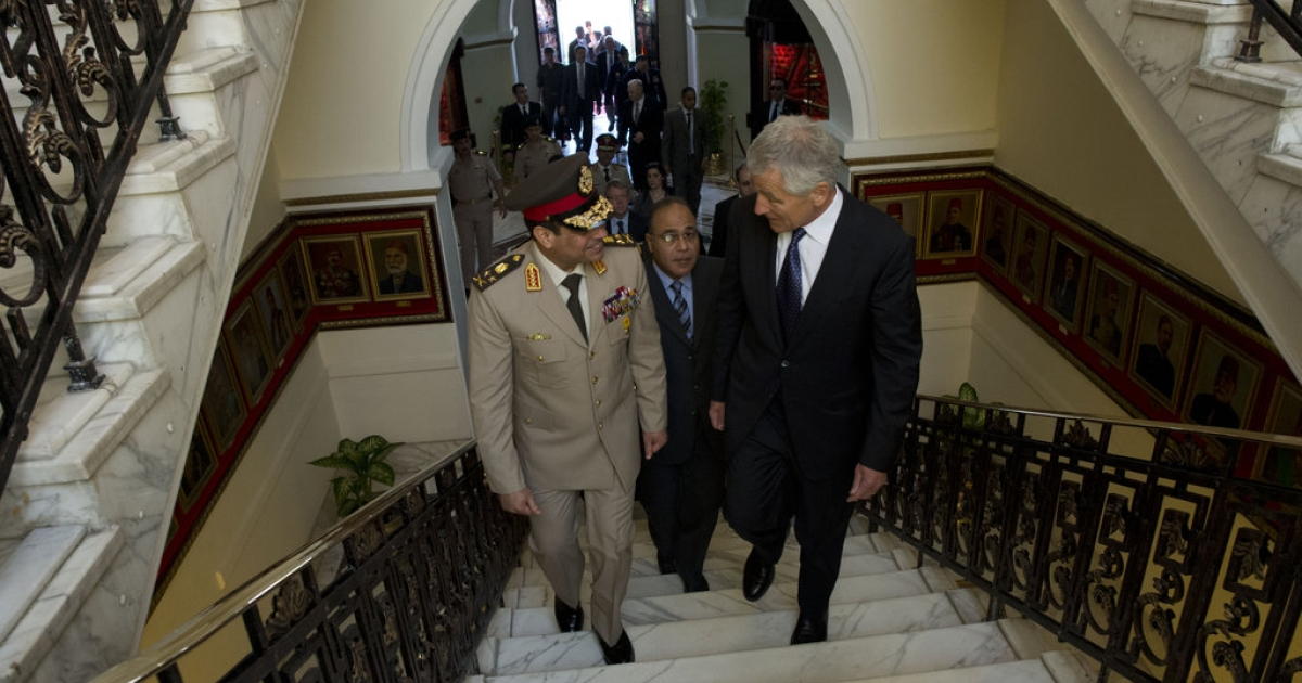 U.S. Secretary of Defense Chuck Hagel, right, walks with Egyptian Minister of Defense Gen. Abdel-Fattah el-Sisi into the Ministry of Defense in Cairo April 24, 2013. Egypt was Hagel's fourth stop on a six-day trip to the Middle East to meet with defense counterparts.</p>