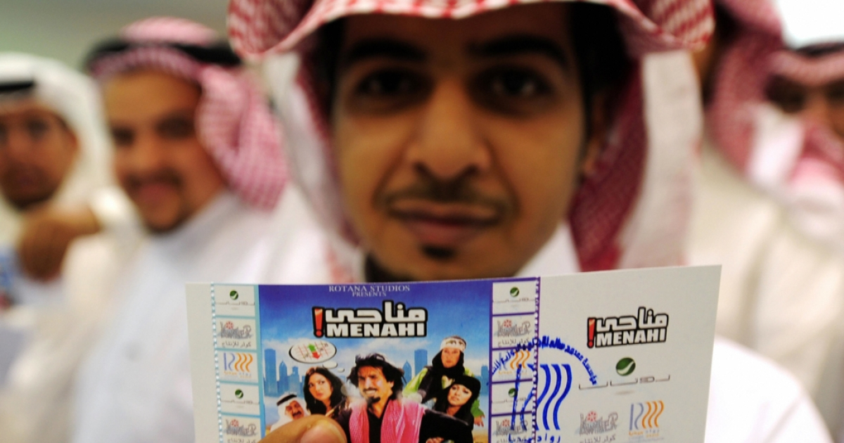 A Saudi man holds up his entrance ticket to see the Saudi comedy film 'Manahi' at a theatre in Jeddah in 2008. The conservative kingdom normally places a blanket ban on public film screenings and movie theaters.</p>
