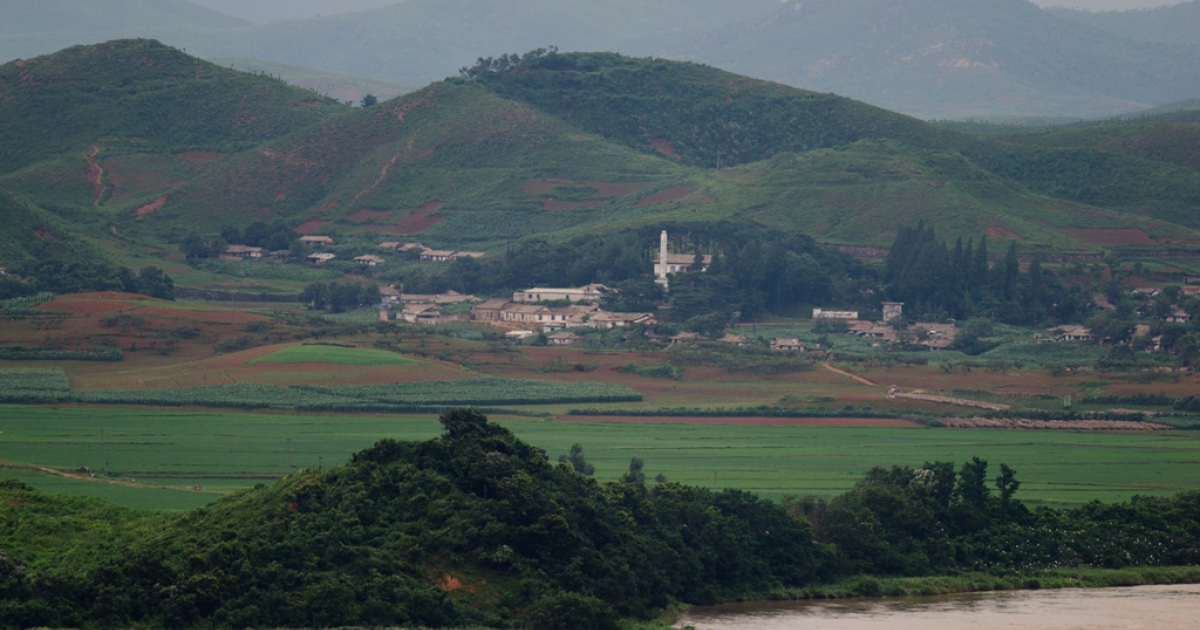 A photo taken on July 16, 2013 shows a North Korean propaganda village of Jangdan-myeon on the edge of the Imjingang river seen from the Odu Mountain Unification Observatory in Paju, South Korea.</p>