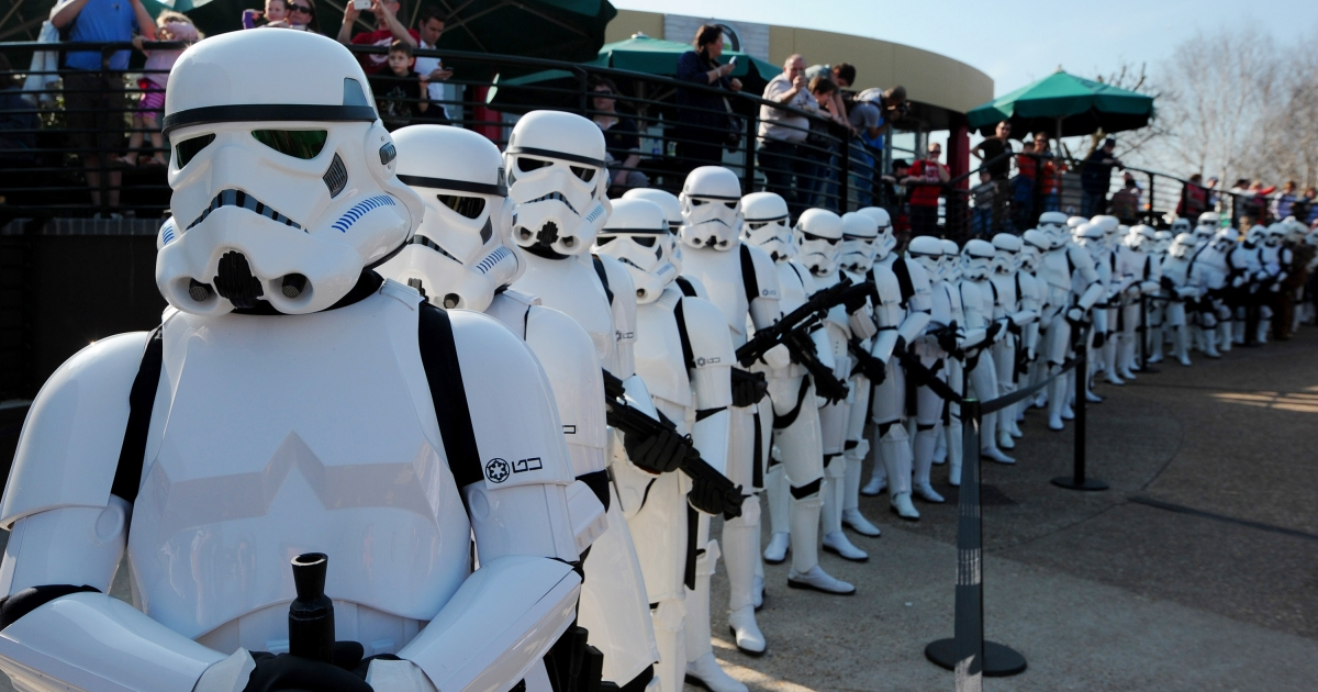 Star Wars Stormtroopers pose for photographers in a queue at Legoland in London to mark the launch of the new Star Wars Miniland Experience.</p>