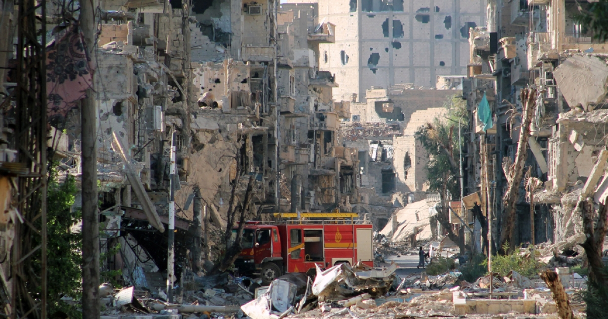 A picture shows a firetruck left amid heavily damaged buildings in the Syria's eastern town of Deir Ezzor on September 10, 2013. The United States is waiting to see a Russian proposal to put Syria's chemical weapons stock under international control, but will not wait for long, top diplomat John Kerry said.</p>