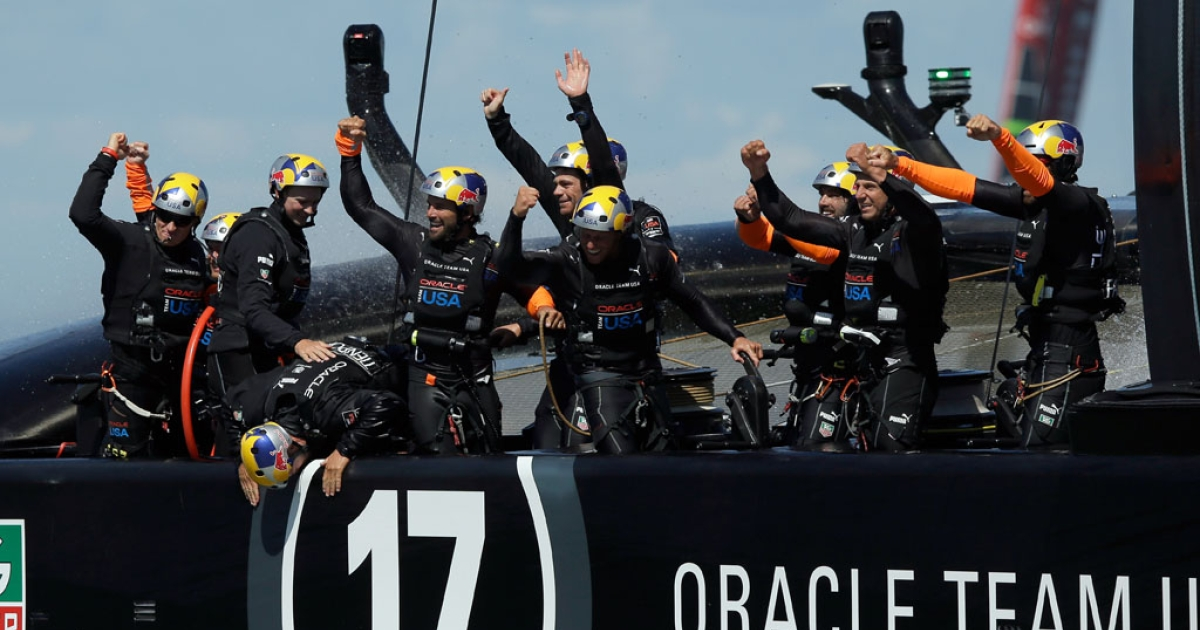 Oracle Team USA crew members skippered by James Spithill celebrates after they beat Emirates Team New Zealand skippered by Dean Barker in race 19 to win the America's Cup on September 25, 2013 in San Francisco, California.</p>