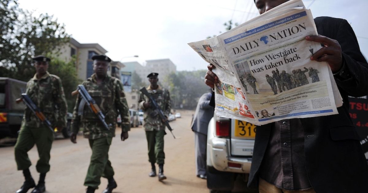 A man reads today's paper in Nairobi on Sept. 25, 2013 after Kenyan forces took back control of Westgate mall following a deadly four-day siege that left more than 60 people dead.</p>