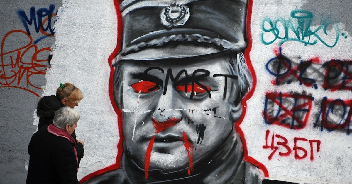 Reminder of the recent past: Belgrade graffiti showing former Bosnian Serb military leader Ratko Mladic, on trial at the International Criminal Tribunal in the Hague.</p>