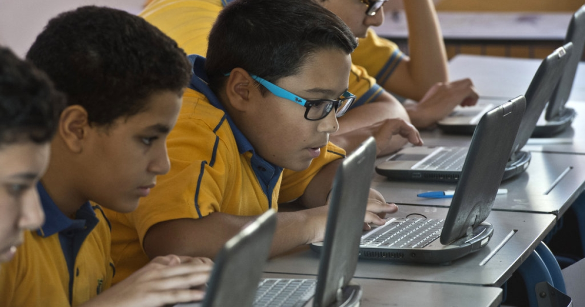 Egyptian students attend a secondary school class at the 'Futures Tech' private school in Cairo on October 23, 2013. Classes are overcrowded, curriculums out of date and facilities crumbling. In Egypt, frustrated parents have for decades relied on private tutors as overpopulation and government neglect have eviscerated public education.</p>