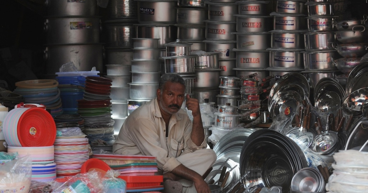 A Pakistani vendor waits for customers at his shop in Karachi on June 2, 2012.</p>