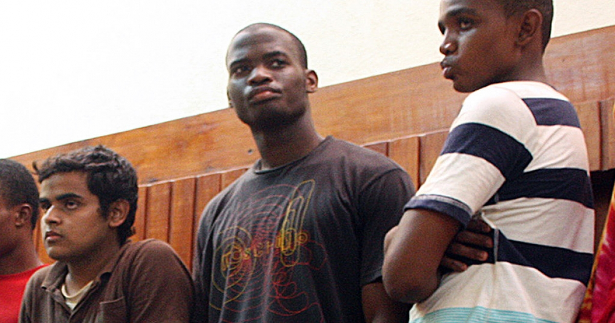 This photo taken on November 23, 2010 shows Michael Adebolajo (C) among the nine suspected members of the Al-Shabaab Movement arrested by Kenyan police on November 22 on claims of being Al-Shabaab recruits on their way to Somalia at the weekend. Michael Adebolajo, one of the main suspects in the brutal murder of a soldier in London, was arrested in Kenya more than two years ago for seeking terror training, it emerged on May 26, 2013, after police made more arrests.</p>