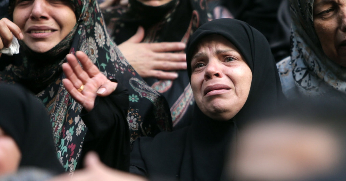 Shia women mourn during the funeral of four Iranian embassy security guards who were killed in the suicide attack outside the Iranian Embassy in Beirut. Thousands of people turned out to mourn for the guards, all of whom were members of Lebanon's powerful Shia movement Hezbollah, which is also backed by Iran and is fighting alongside Assad's troops against Sunni-led rebels.</p>