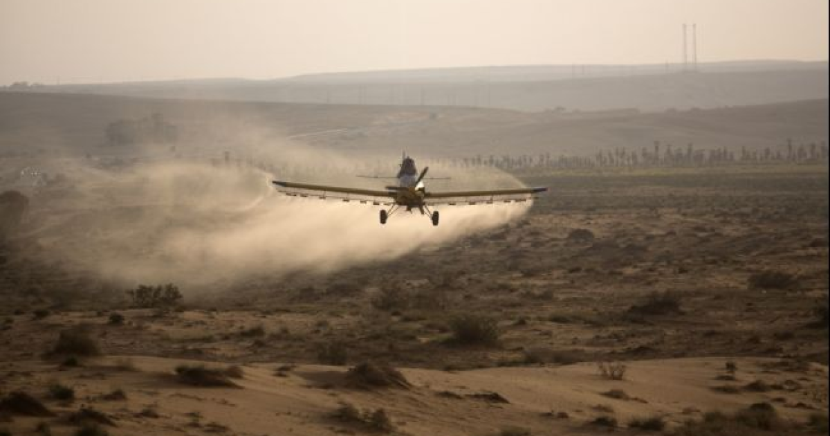 A plane flying over the Israeli village of Kmehin in the Negev Desert near the Egyptian border in March 2013.</p>
