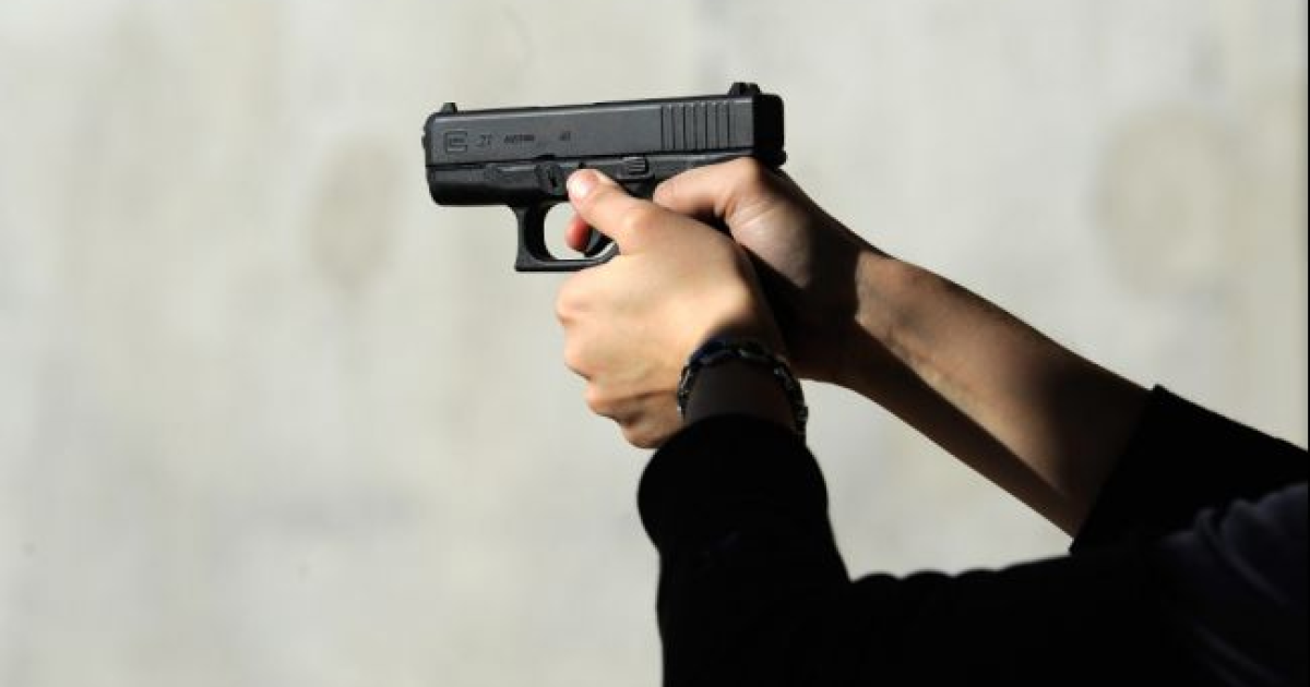 Alexis Silva shoots her Glock 27 .40 caliber handgun at the Southwest Regional Park shooting range near the Crossroads of the West Gun Show at the Pima County Fairgrounds on January 15, 2011 in Tucson.</p>
