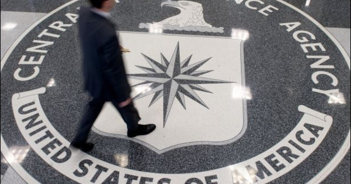 A man crosses the Central Intelligence Agency (CIA) logo in the lobby of CIA Headquarters in Langley, Virginia.</p>