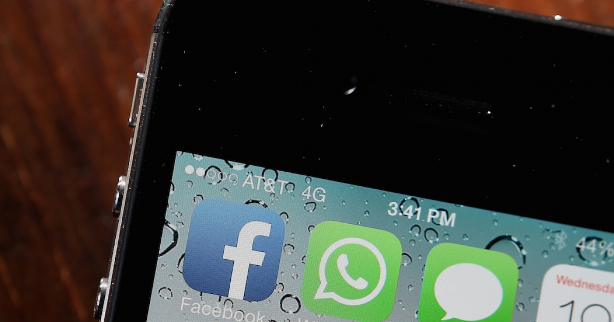 The Facebook and WhatsApp app icons are displayed on an iPhone on February 19, 2014 in San Francisco.</p>