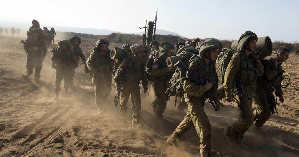 Israeli soldiers from the Golani Brigade take part in a military training exercise in the Israeli-annexed Golan Heights near the border with Syria.</p>