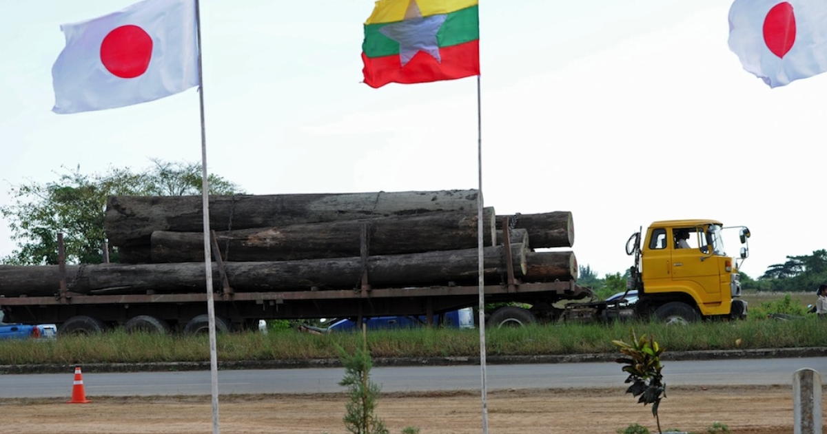 A truck loaded with logs drives past the flags of Myanmar and Japan during the Commencement Ceremony of Thilawa Special Economic Zone Project in Thilawa, on the outskirts of Yangon on November 30, 2013. Thilawa SEZ (Special Economic Zone) will be built on 2400 hectares of land on the outskirts of Yangon.</p>