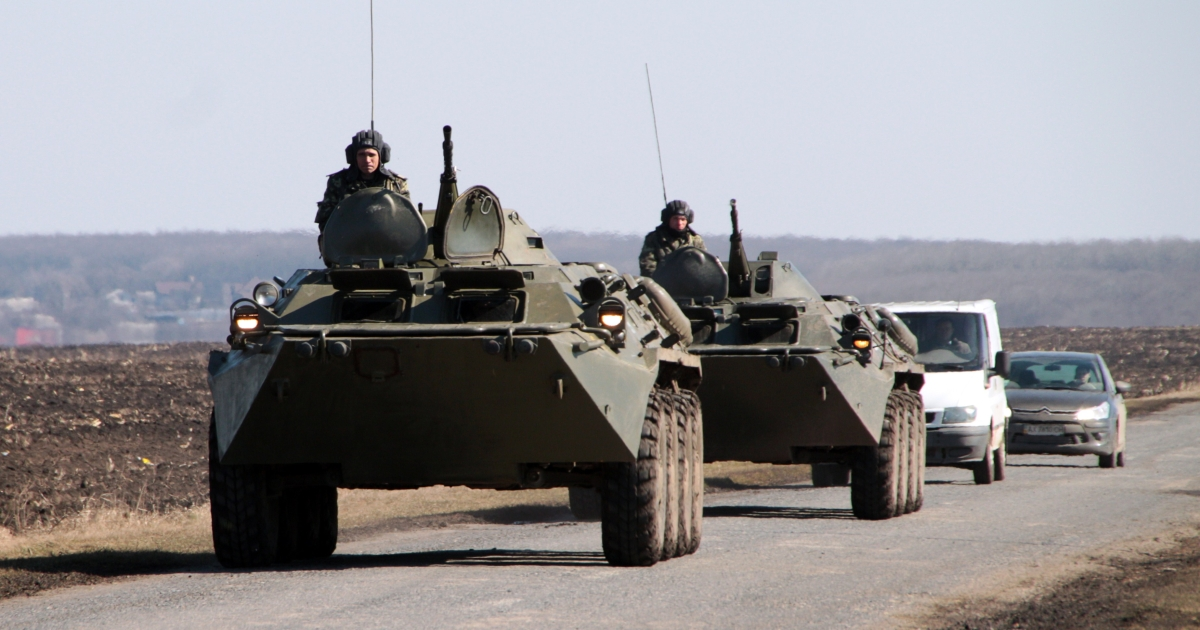 A Ukrainian armored vehicle takes position near the border with Russia. Eyewitnesses filmed miles of Russian armored vehicles moving toward the border on April 24, 2013.</p>