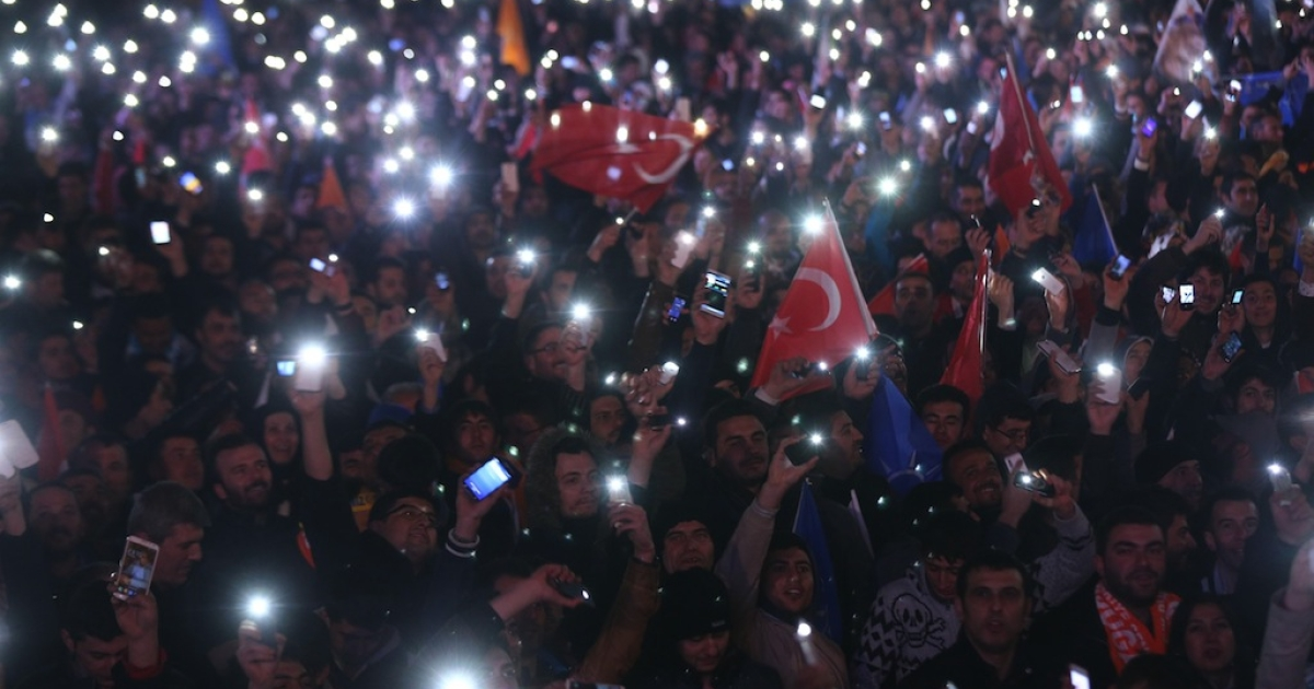 Supporters of Turkey's ruling AK party (AKP) cheer as they follow the election's results in front of the party's headquarters in Ankara, on March 30, 2014. The party of Turkish Premier Recep Tayyip Erdogan took a strong early lead in local elections, despite turbulent months marked by mass protests, corruption scandals and Internet blocks.</p>