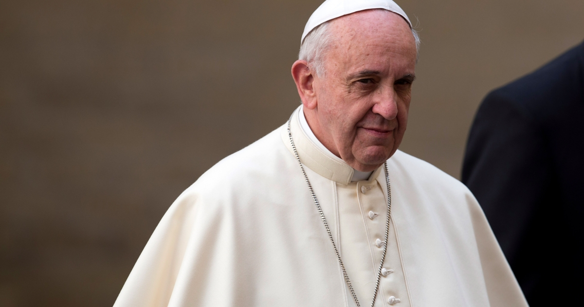 Pope Francis, leaves after hosting an audience with Her Majesty Queen Elizabeth II and Prince Philip, the Duke of Edinburgh, in the pope's study during their one-day visit to Rome on April 3, 2014</p>