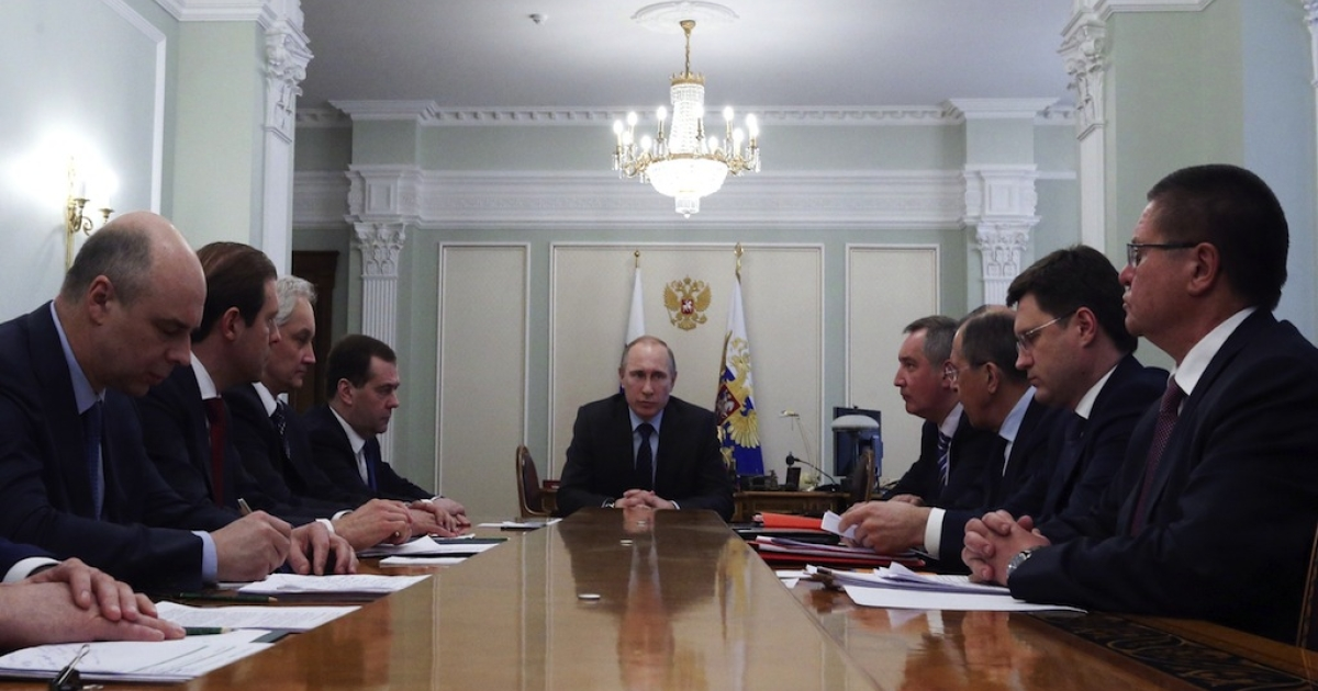 Russia's President Vladimir Putin attends a meeting with members of the government at the Novo-Ogaryovo state residence outside Moscow, April 9, 2014. Putin on April 9 ordered Ukraine to come to the negotiating table over its unpaid energy bills, warning that it would otherwise require payment in advance for gas. Ukraine