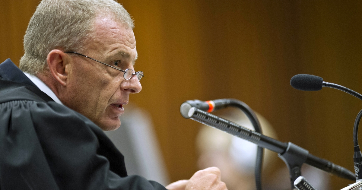 State prosecutor Gerrie Nel questions Oscar Pistorius during cross examination in the Pretoria High Court in South Africa.</p>