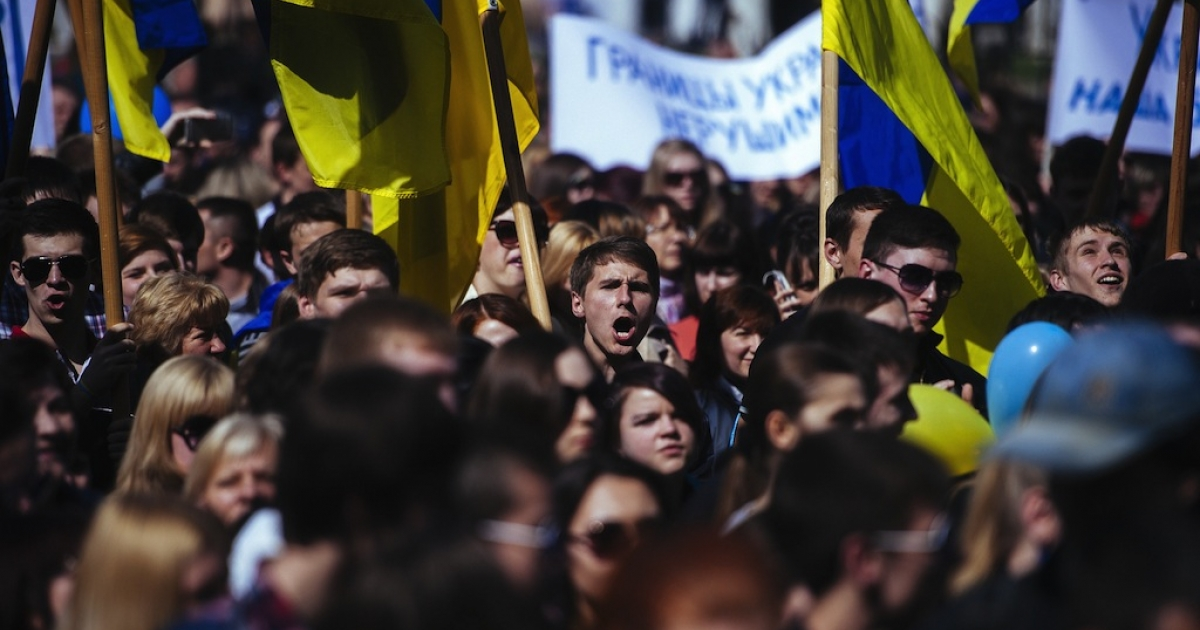 A Ukrainian student shouts slogans during a nationalist and pro-unity rally in the eastern city of Lugansk on April 17, 2014. Russia's Foreign Minister Sergei Lavrov today announced a deal had been reached with Ukraine, the US and the EU to