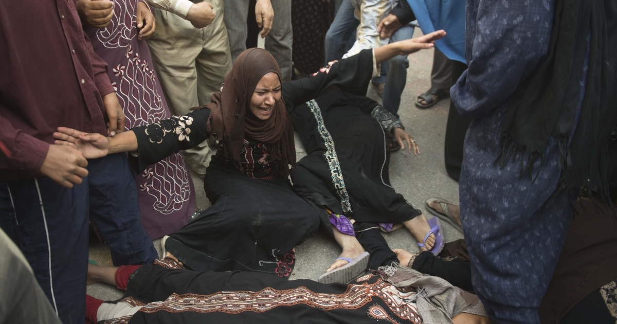 Egyptian women faint as they react outside the courtroom in Minya after the sentences were announced.</p>