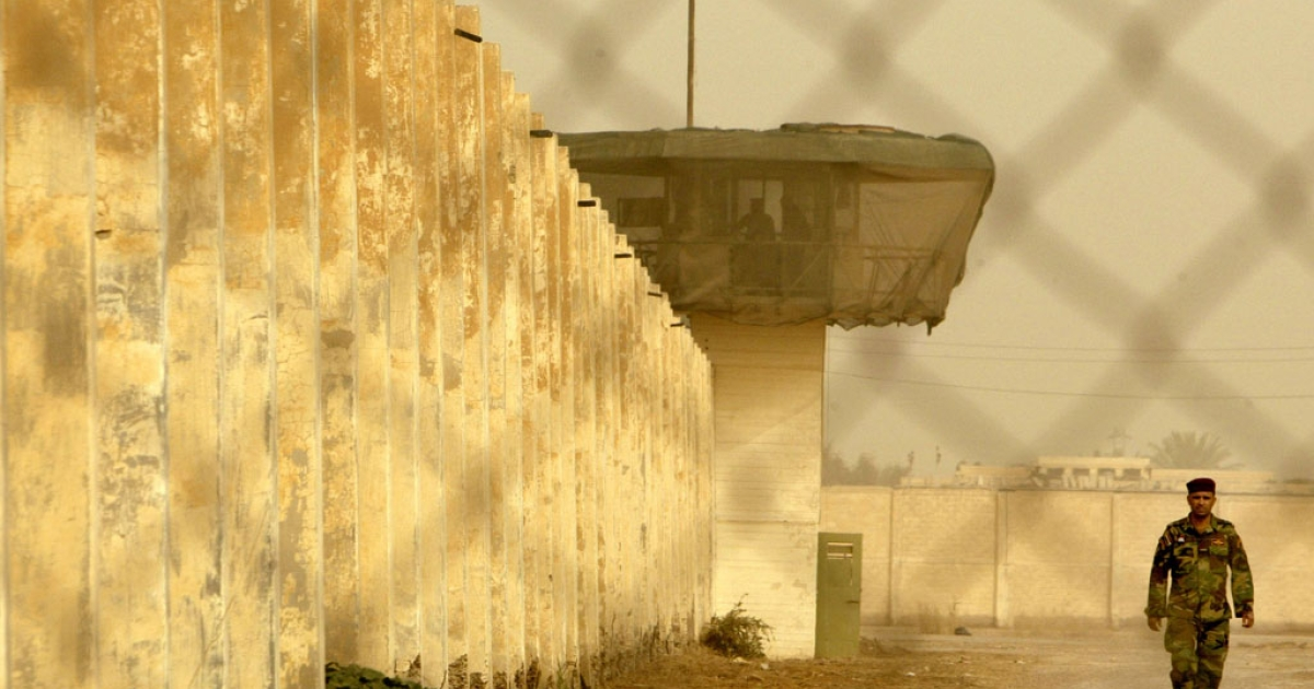 An Iraqi security officer patrols the grounds at the Baghdad Central Prison in Abu Ghraib on Feb. 21, 2009.</p>