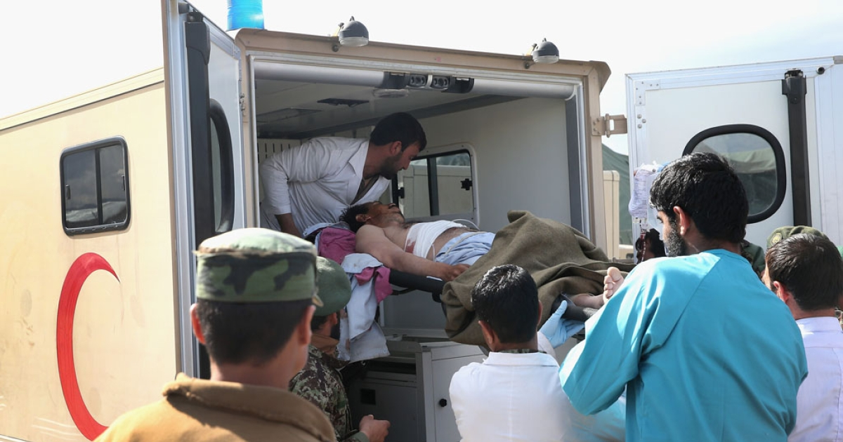 A man who was shot in the chest while on his way to vote is loaded into an ambulance at Camp Maiwand, an Afghan National Army base, on April 5, 2014 near Pul-e Alam, Afghanistan.</p>