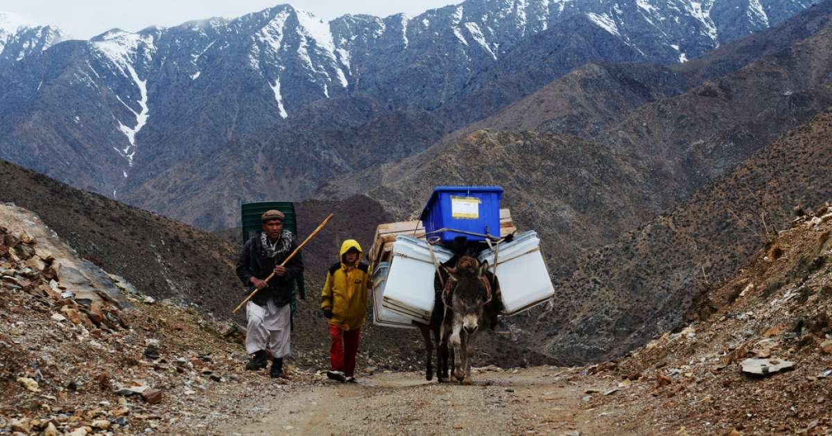Afghan villagers use donkeys to transport election material in the mountains of Shutul District in northern Afghanistan on April 4, 2014.</p>