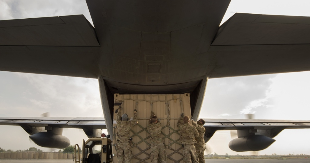Air Force aerial porters load a shipping container onto a C-130 Hercules cargo plane at Forward Operating Base Salerno, Khost Province, Afghanistan, Sept. 22, 2013. The 19th MCT, a small squadron of Air Force surface movement controllers and aerial porters, have the herculean task of overseeing the vast majority of retrograde operations at FOB Salerno.</p>