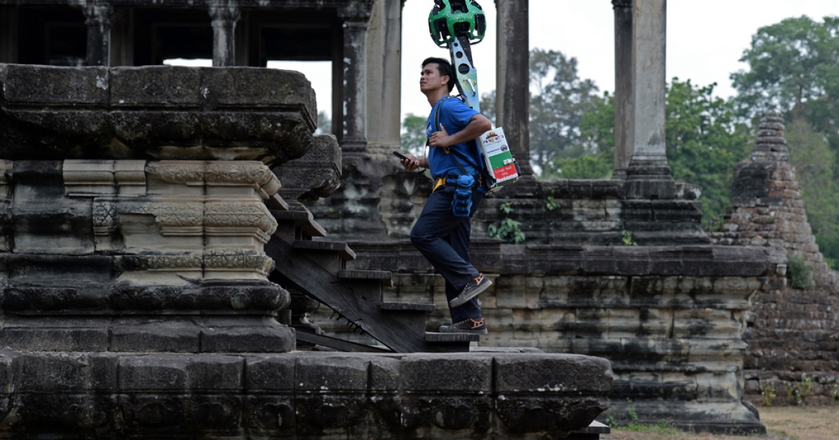 A Cambodian technician carries a back-pack mounted with a device housing 15 cameras as he demonstrates the technique used to digitally map the Angkor Wat temple, part of the Angkor architectural complex in northwestern Cambodia on April 3, 2014.</p>
