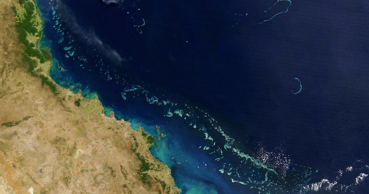 Stretching along more than 1,200 miles along Australia's eastern coast the Great Barrier Reef, seen here from space, is one of the world's foremost natural wonders. Scientists object to new plans to dump and drill in its midst.</p>
