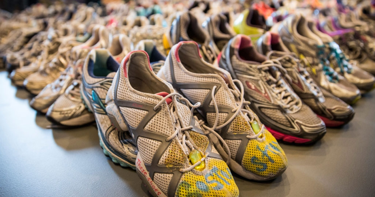 Runners' shoes are laid out in a display titled, 'Dear Boston: Messages from the Marathon Memorial' in the Boston Public Library to commemorate the 2013 Boston Marathon bombings, on April 14, 2014 in Boston, Mass.</p>