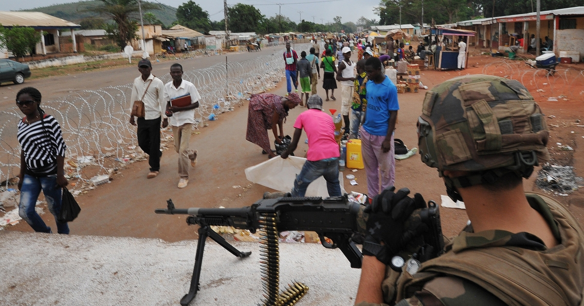 A French soldier of the Sangaris military operation takes position at the PK12 checkpoint on March 1, 2014 in Bangui.</p>