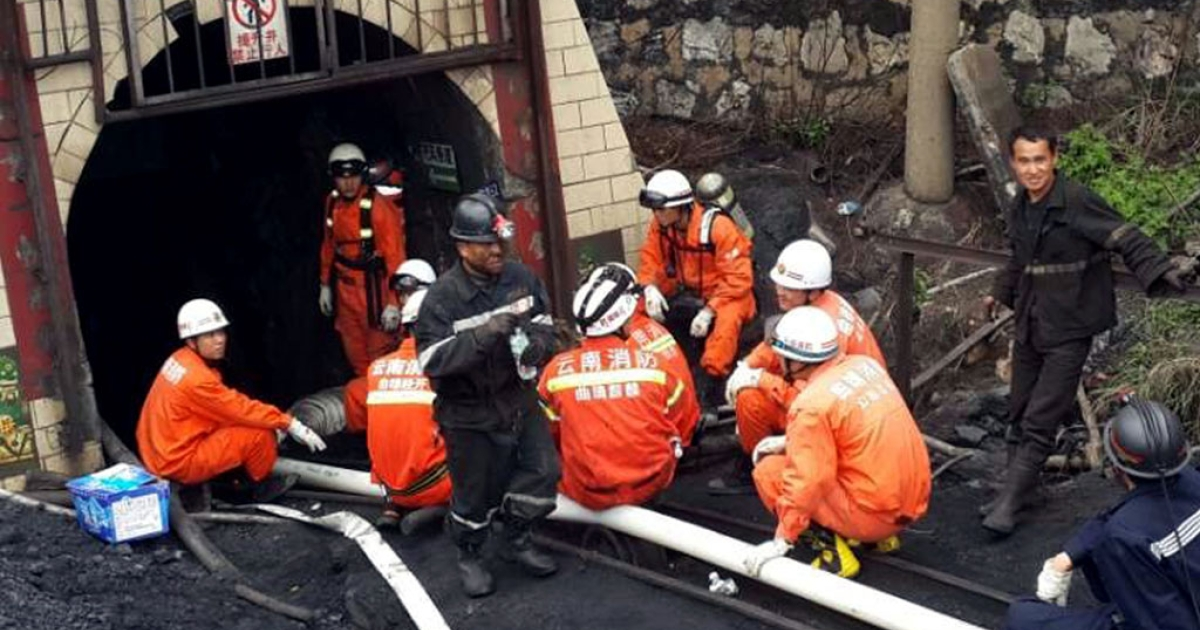 Rescuers rest after they made the first attempt to save the 22 miners trapped in a flooded coal mine in Qujing on April 7, 2014.</p>