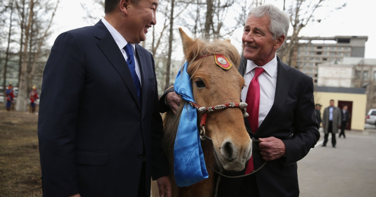 US Secretary of Defense Chuck Hagel is presented with a horse by his Mongolian counterpart, Defense Minister Bat-Erdene Dashdemberel, in the Mongolian capital of Ulaanbaatar on April 10, 2014.</p>