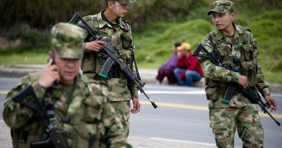 Soldiers patrol the Bogota-Tunja highway in Colombia on the first day of a national strike by farmers protesting against the government for alleged unpaid benefits on April 28, 2014.</p>