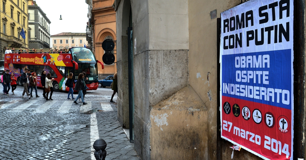 A poster bearing the logos of far-right Italian parties says