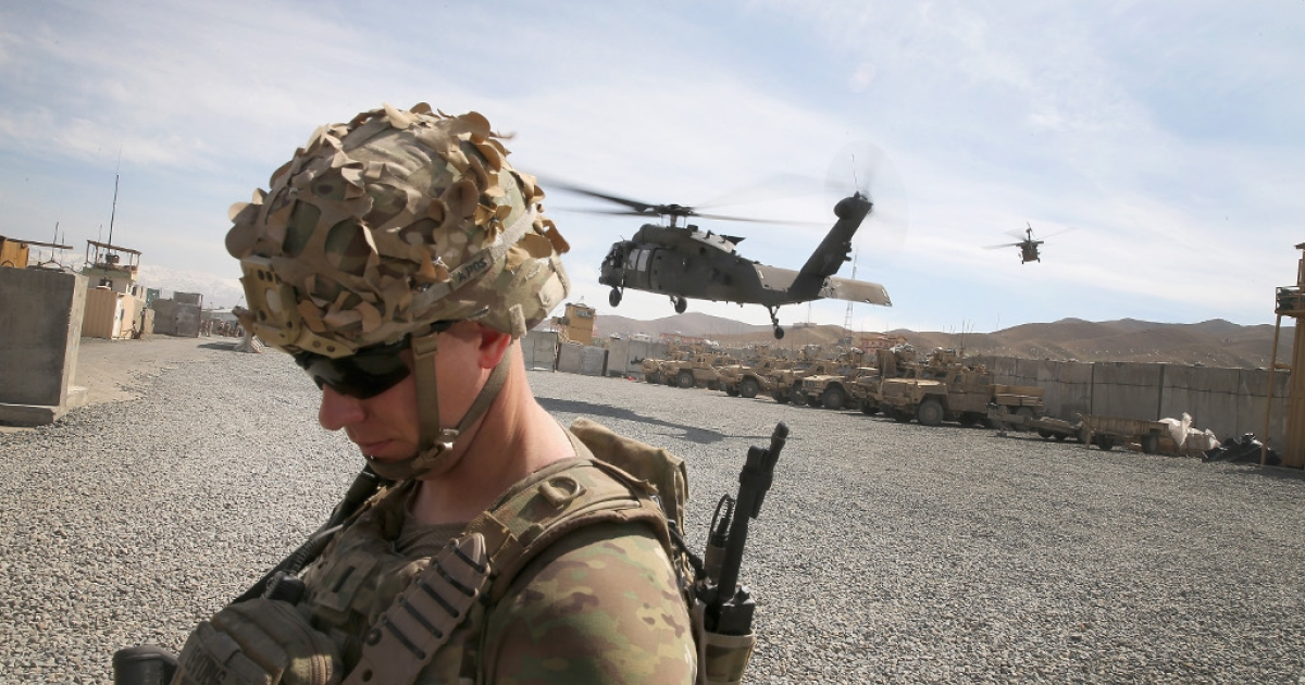 Helicopters carrying US Army leaders take off in Pul-e Alam, Afghanistan on March 26, 2014.</p>