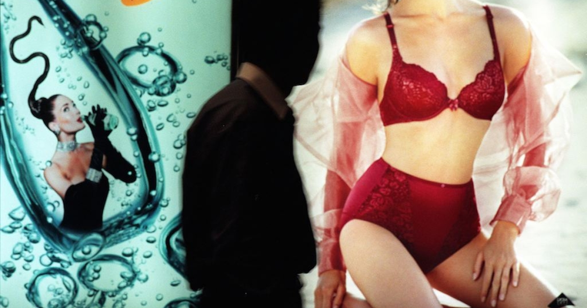 A sexy lingerie ad interests a commuter in Hong Kong's underground subway. He's apparently an outlier.</p>