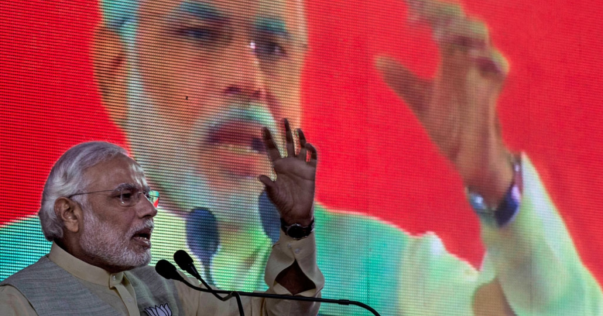 Bharatiya Janata Party leader Narendra Modi speaks during a meeting to announce the party's election manifesto on April 7, 2014 in New Delhi, India.</p>