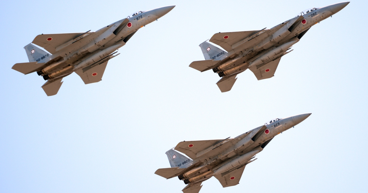 F-15 jets fly during the military review at the Ground Self-Defence Force's Asaka training ground on October 27, 2013.</p>
