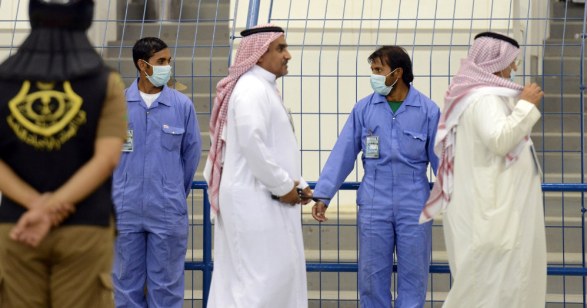 Workers wear mouth and nose masks while on duty during a football match in Riyadh on April 22, 2014. The health ministry reported more MERS cases in the city of Jeddah, prompting authorities to close the emergency department at the city's King Fahd Hospital.</p>